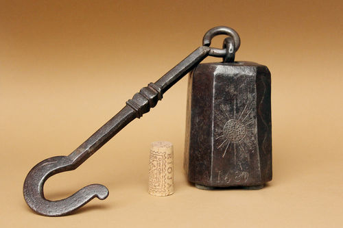 Iron weight, dated 1680